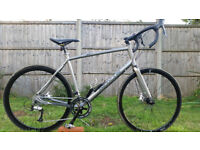 WHYTE RACING BIKE..XL FRAME..700c WHEELS..18 SPEED.NEW CONDITIONS BIKE..DISC BRAKES..READY TO RIDE