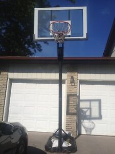 Basketball net with single lever height adjustment