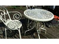 Cast alloy decrative vintage style table and 2 chairs..