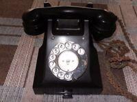 Vintage black Bakelite GPO telephone.