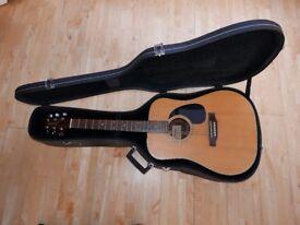 Takamine Jasmine Acoustic TS70 guitar with hard case.