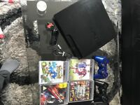 PS3 with 2 pads and games