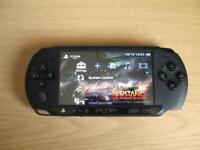 psp e1000 with 32 gb memory & 200 games