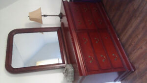 Bed Frame, 2 night tables and a dresser with a mirror