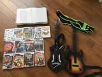 Wii bundle Guitars base and lots of games