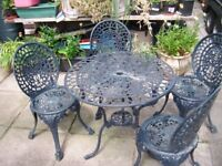 metal table and 4 matching chairs navy blue
