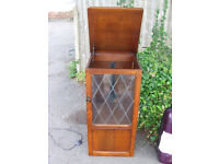 A Glass fronted display unit / Storage with lifting top