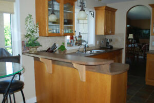 Pristine oak kitchen cabinets