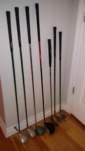 Assorted left golf clubs, drivers irons and putter
