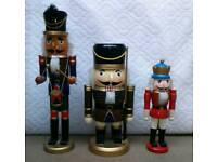 Three nutcracker wooden puppets