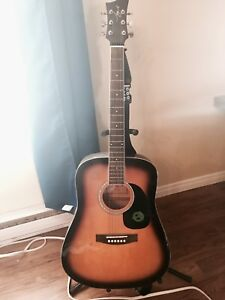 Acoustic guitar , stand and strap