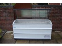 Commercial Curved Glass Top, Chest Freezer. Cheapest available on Gumtree and on the internet.