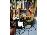 Fender Squire Strat electric guitar (back and white) + Fender Amp
