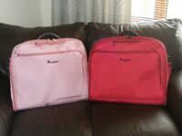 2x IT luggage suit carriers. Never been used.