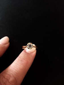 Beautiful gold ring with diamonds & amythest