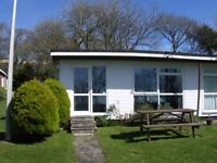 Autumn breaks in 2 bed bungalow with country and sea view