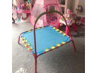 Children's trampoline with handle