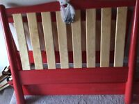 Red wooden single bed, suitable for child or teen. Great condition. All screws with it