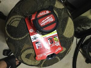 Milwaukee tape measure and 18 volt lithium battery