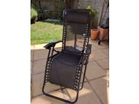 Two black textoline garden loungers-good condition- £25 for the pair