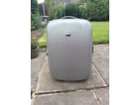 Silver perforated suitcase