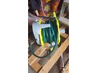 garden pipe reel on stand
