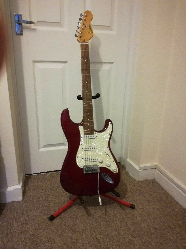 Encore Electric Guitar and stand. good condition.(stat copymaroon with pearl scratch platein Norwich, NorfolkGumtree - Encore Electric Guitar, copy of a Fender Stratocastergood working order withe small stand no longer needed, Quick sale. Offers