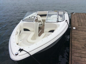 18' Larson boat with trailer