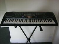 casio keyboard, with stand.