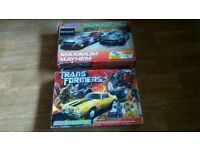 2 x micro scalextric sets- transformers / aston martin db9