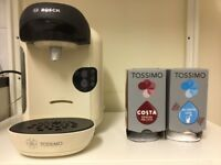 BRAND NEW Bosch Tassimo Vivy Coffee Machine, pod stand and a large amount of pods