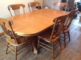 Solid wood extending dining table and six chairs