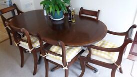 Extendable dark wood table and 6 chairs