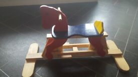 Brightly coloured rocking horse. Fabulous condition. Smoke free home.