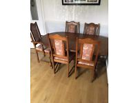 Extendable wooden dinning table with six chairs