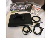 PS3 SuperSlim Console with games and leads