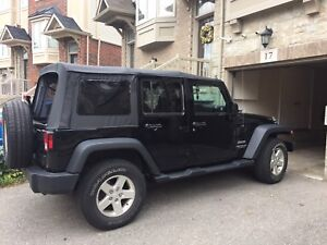 2014 black Jeep Wrangler unlimited. Low km
