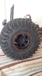 SET OF ROX LOX 4.0 TIRES AND AND BEADLOCK RIMS.