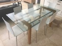 Glass dining table and 6 white chairs