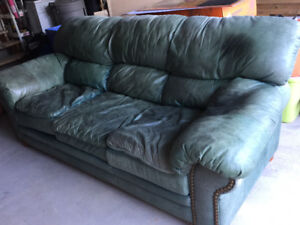 Used forest green leather couch & loveseat