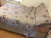 Small double divan bed with storage