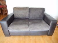 DARK BROWN LEATHER / FABRIC TWO SEATER SOFA AND OTTOMAN / FOOT STALL IN GOOD USED CONDITION
