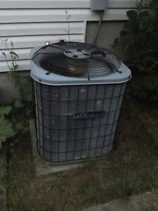 Air conditioner for forced air