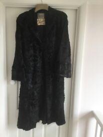 Black calf length fur coat