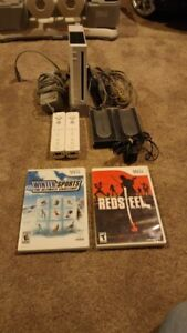 NINTENDO WII INCLUDES 2 REMOTES AND 2 GAMES AND LOTS MORE