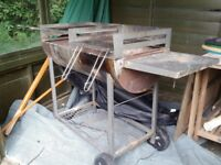 Large double barrell BBQ with food out side table and storage below