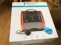 Karaoke Singing Machine. SML343BK. Brand new in box. Unwanted gift.