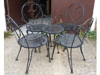 Metal Set Of Four Chairs With Sweet-Hart Backs And A Small Table For The Garden Or Patio.