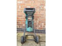 Bosch Garden Shredder. Reversible action. Slot is 40mm x 135mm approx. Mains powered.
