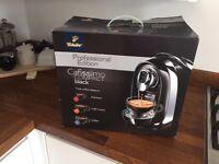 Capsule coffee machine and capsule holder